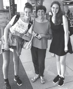 At the Charlotte airport leaving for France July 3 are (l-r) Ciara Rennicks, Jan Collins, and Emma Rennicks.